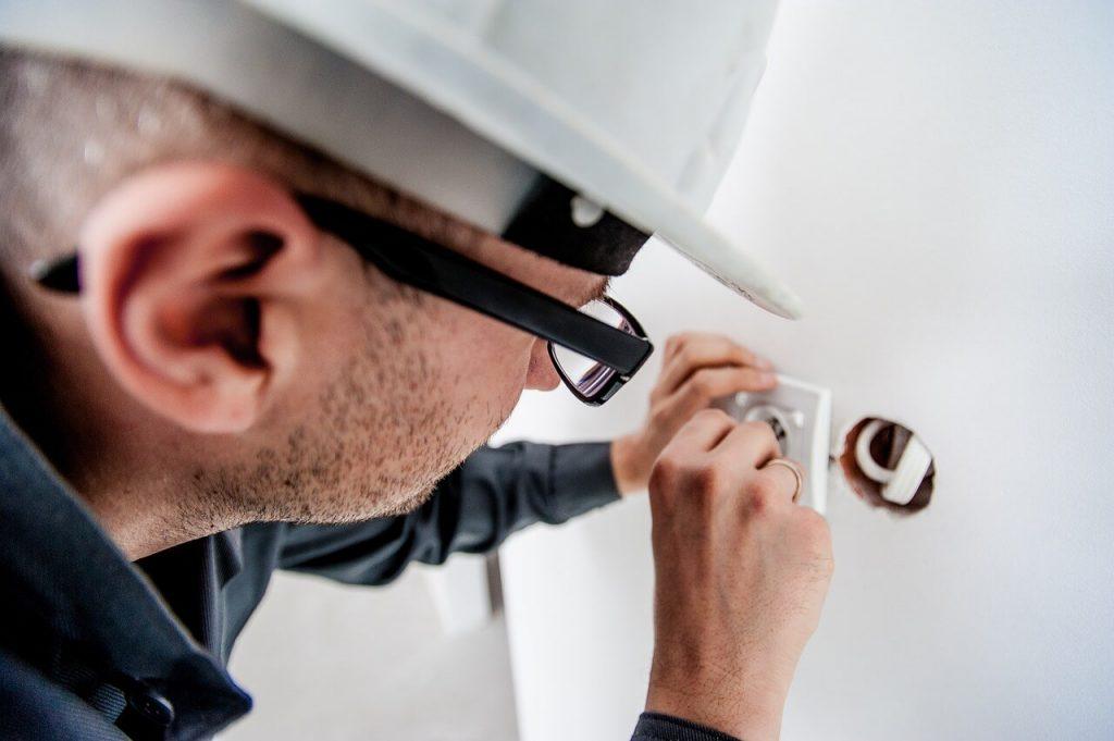 Man Repairing Electrical Wiring